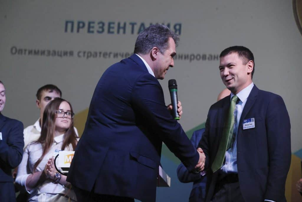 Alexey Tsoy accepting first prize at MineTech-2nd Mining Technical Challenges and Solutions Competition