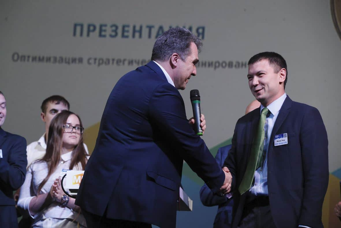 Alexey Tsoy receiving first place at the 2018 MineTech-2nd Mining Technical Challenges and Solutions Competition