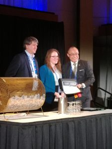 President, Stan Wholley, Winner of the Joan Bath Bursary Award, Rebecca Montsion and PDAC Vice President, Felix Lee.