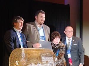 President Stan Wholley, Winner of the Peter Howe Bursary Award, James Kidder, Jovette Howe and PDAC Vice President, Felix Lee.